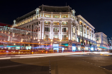 regent: Night view on a corner building in one of the busiest streets in london