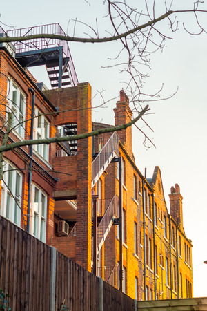typically british: A block of traditional luxury flats in london during the sunset.  Stock Photo