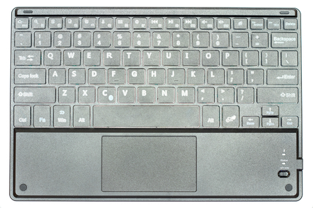 wireless bluetooth black keyboard, made in plastic isolated in white background.
