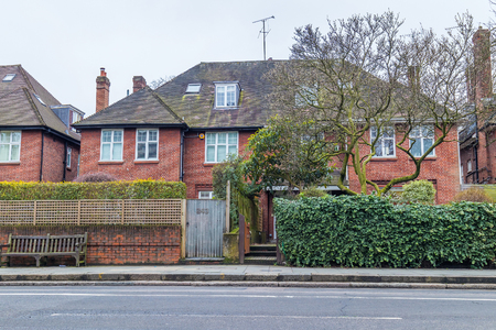 redbrick: Typical detached house in London suburbs with a large garden in front. Made of orange clay bricks Stock Photo