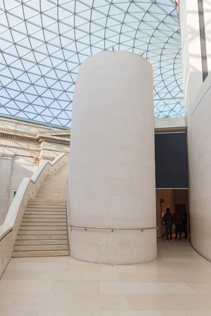 Interior view to the architecural details of the glass dome and stairs of a museum in London Editorial