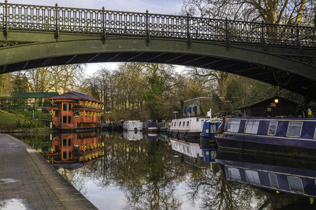 typical red chinese restaurant built ontop of a boat in a british water canal