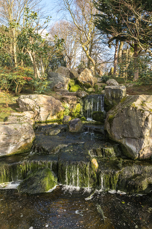 Small man made cascade in the public park in a portrait orientation