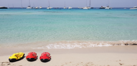 Paraside beach in formentera, ibiza with three electric motorized scuba diving