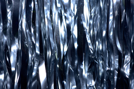 Plastic sheet metal shiny. When it hits light it will reflect. Put together Use as a beautiful backdrop. Feel like a metal curtain. Foto de archivo