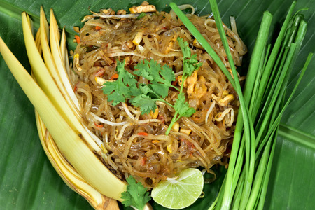 Pad Thai is a traditional Thai food, delicious and famous. People around the world know Cooked with stir fried noodles with many kinds of ingredients. Serve on banana leaf.