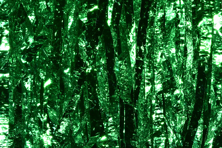 Plastic sheet metal shiny. When it hits light it will reflect. Put together Use as a beautiful backdrop. Feel like a green metal curtain.