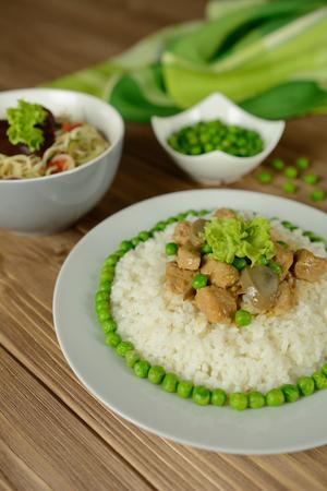 Rice with pork, mushrooms, pea and sauce