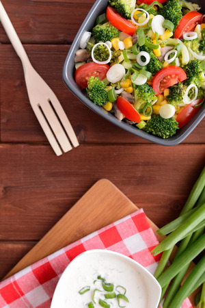vitamin rich: Broccoli salad with tomatoes, corn and onion Stock Photo