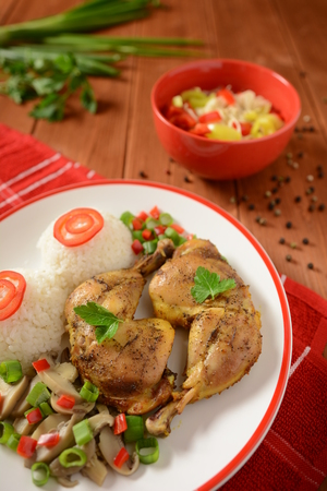 Chicken thighs with white rice, mushrooms and pepper Stock Photo