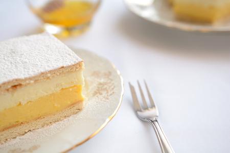 honey cake: Honey cake with vanilla and whipped cream Stock Photo