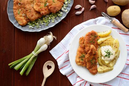 schnitzel: Wiener schnitzel with boiled potatoes