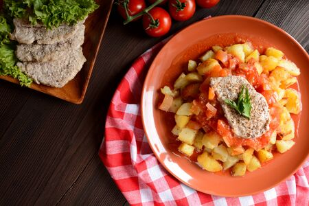 potatos: Pork cutlet with roasted potatoes, peppers and sauce