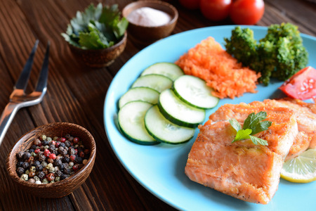 blue fish: Fried salmon with vegetable Stock Photo