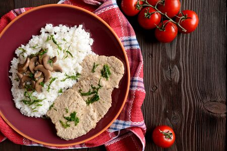 loin: Pork loin fillets with rice and mushrooms