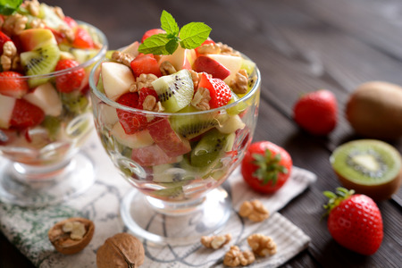 Fruit salad in a glass bowl Stock Photo