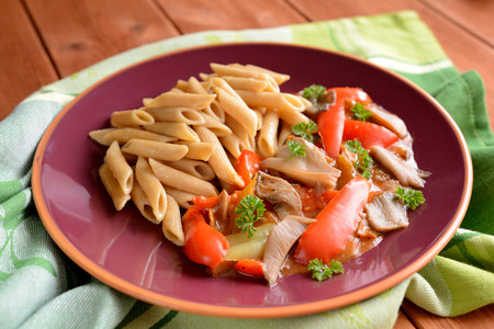 whole wheat: Stewed oyster mushrooms with peppers and whole wheat pasta Stock Photo
