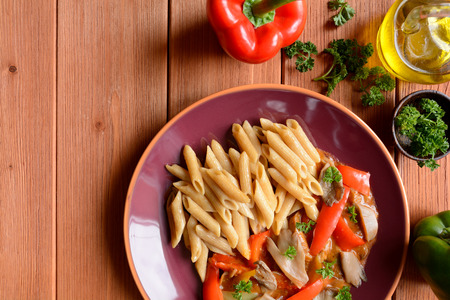 Stewed oyster mushrooms with peppers and whole wheat pasta Stock Photo