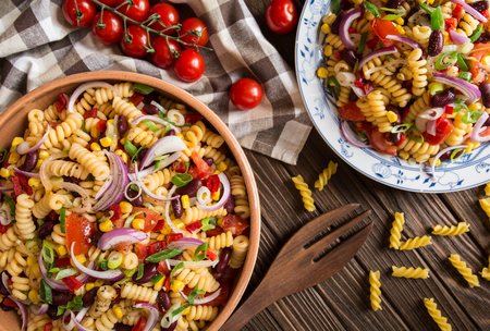 Vegetarian Mexican macaroni pasta salad with red bean, corn, tomato, onion and pepper Stock Photo