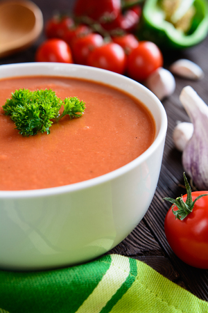 Traditional vegetable soup gazpacho in a white bowl