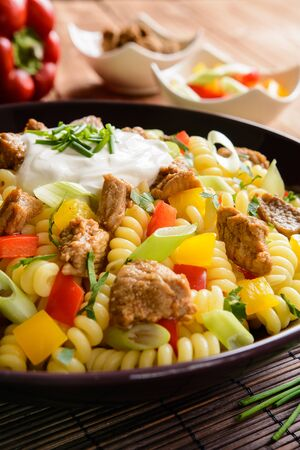 quick snack: Fusilli pasta salad with fried pork, pepper, green onion, parsley and sour cream dressing