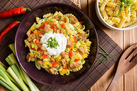 Fusilli pasta salad with fried pork, pepper, green onion, parsley and sour cream dressing