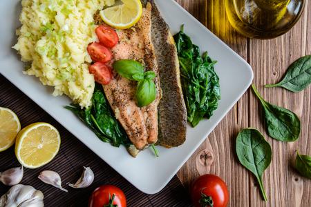 vitamin rich: Baked rainbow trout fish with mashed potatoes and steamed spinach Stock Photo