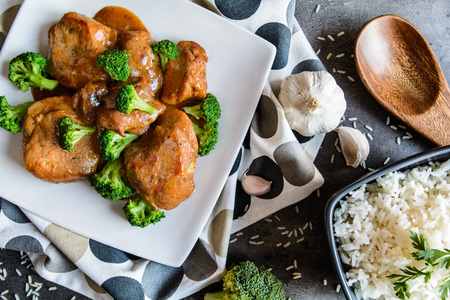 Steamed pork thighs with balsamic vinegar sauce and roasted broccoli and rice