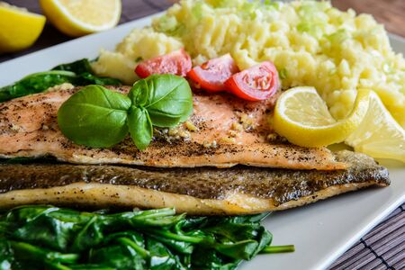 rainbow fish: Baked rainbow trout fish with mashed potatoes and steamed spinach Stock Photo