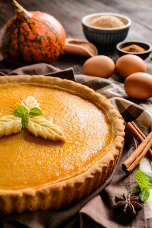 Traditional American pumpkin pie with cinnamon and mint