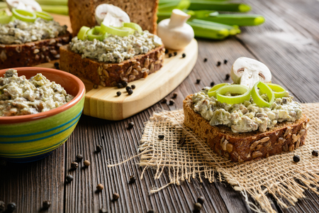 whole wheat toast: Slice of whole wheat toast with mushroom spread with Roquefort cheese and leek