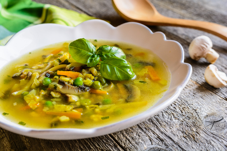 Vegetable soup with carrot, mushrooms, pea, kale, parsley, celery and onion