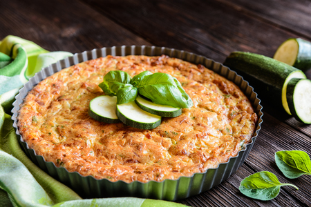 Zucchini pie with bacon, cheese, onion, parsley and basil Stock Photo - 63695706