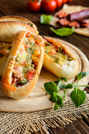 quick snack: Bread boats stuffed with sausage, egg and cheese for breakfast