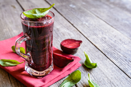 Beetroot smoothie with spinach and lemon in a glass jar