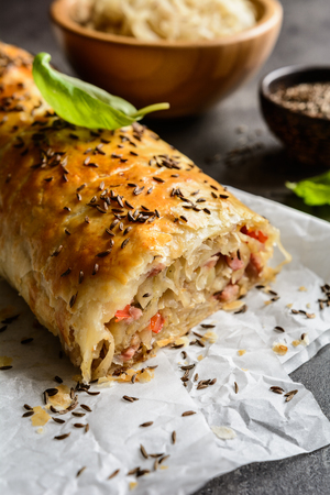 strudel: Savory strudel stuffed with sour cabbage, bacon, red pepper and onion