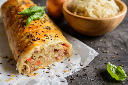 Savory strudel stuffed with sour cabbage, bacon, red pepper and onion