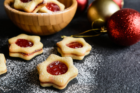 Christmas Linzer cookies stuffed with strawberry jam