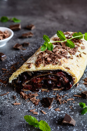filled roll: Strudel stuffed with chocolate and cherry filling