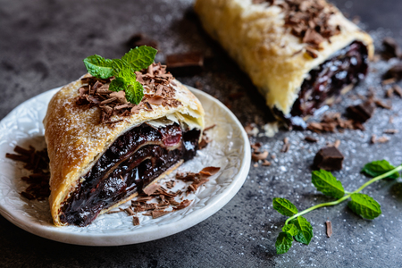 Strudel stuffed with chocolate and cherry filling