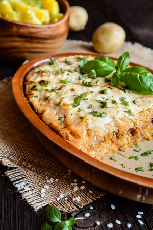 savoy cabbage: Kolozsvari Kaposzta - Varza a la Cluj - layered sour cabbage with minced meat and rice, topped with sour cream, served with potato
