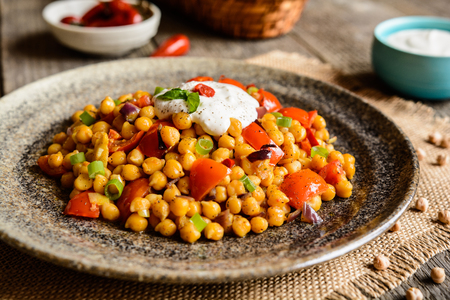 Traditional Indian Channa Masala - spicy chick peas with tomato, pepper and curry Stock Photo