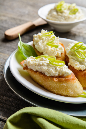 Fried egg baguette slices with horseradish and curd spread Stock Photo