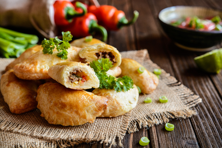 Traditional Empanadas stuffed with minced beef, pepper and corn, served with Aji Picante sauce 写真素材