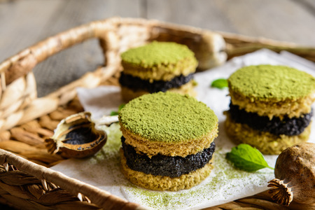 Matcha green tea cakes with poppy seeds filling Stock Photo - 69622846