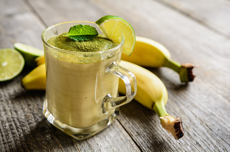 increase fruit: Healthy smoothie with banana and Matcha tea in a glass jar