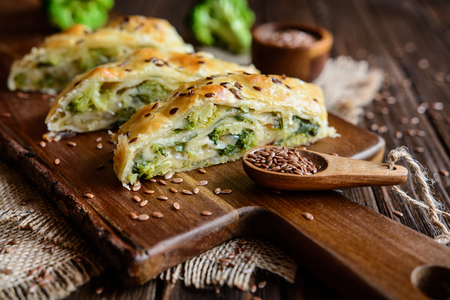 Savory strudel stuffed with broccoli, Mozzarella cheese and onion