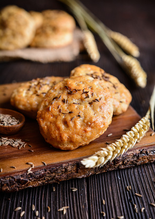 Salty cookies made of ground pork cracklings and sprinkled with cumin