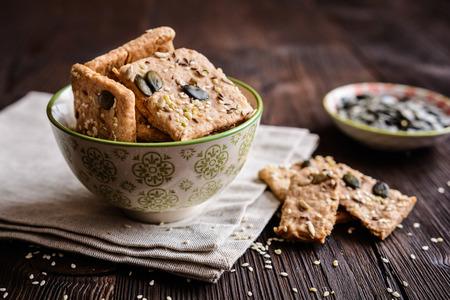 Crackers made of spelt flour and various types of seeds (pumpkin, sunflower, sesame, flax and hemp) Stock Photo - 70172034