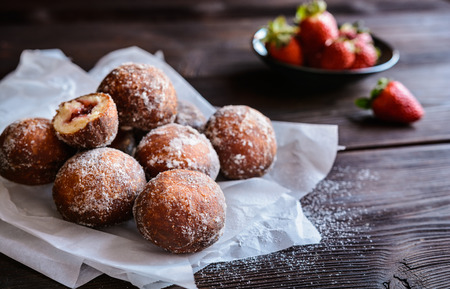 Bomboloni - traditional Italian doughnuts stuffed with strawberry jam
